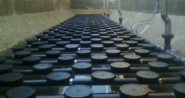 Disc diffusers for aeration systems